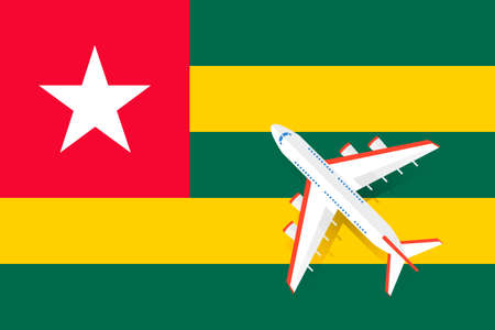 Vector Illustration of a passenger plane flying over the flag of Togo. Concept of tourism and travel Vettoriali
