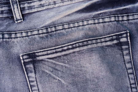 Denim light fabric and back pocket made of cotton. Clean light-colored jeans. Standard-Bild