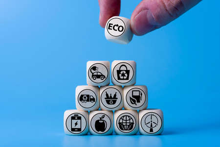 Ecology concept with icons on wooden cubes, blue background. The concept of clean energy for the whole world.