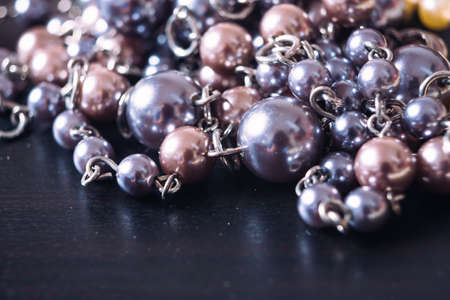 pink pearl: gray and pink pearl necklace on a dark background with reflection Stock Photo