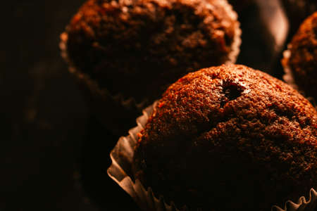 eating utensil: Chocolate muffins with nuts on dark  background, selective focus