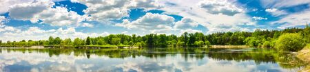 Sky and clouds reflection on Lake Stock Photo - 11297289