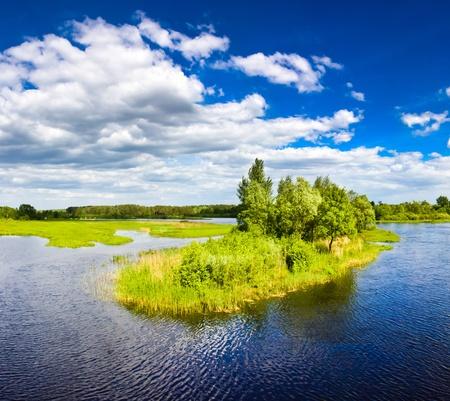 Small island on lake on sunday Stock Photo - 11297304