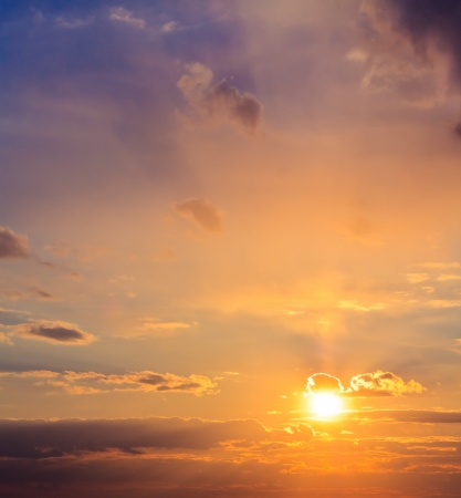 The sun shining over low cloud Stock Photo