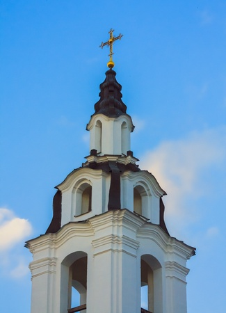 Golden dome of the Orthodox church in Central Russia on the blue sky background