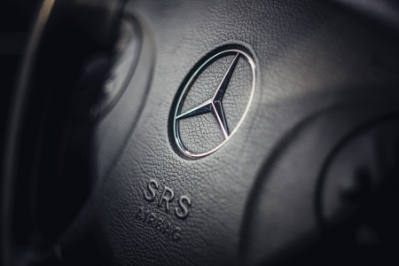 Mercedes Benz black steering wheel and silver star logo