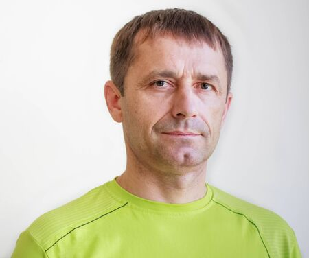 Portrait of casual smiling man in green t-shirt Stock Photo - 17287361