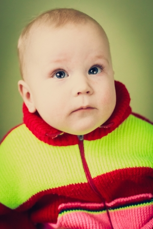 Portrait of sad baby boy looking up and thinking Stock Photo - 17387956