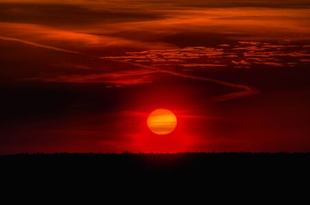 Big Sun Setting. Orange sky and dramatic sunbeams Stock Photo - 17415895