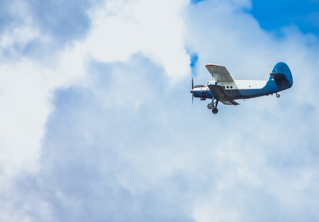 Biplane in blue Sky over clouds Stock Photo - 17471795