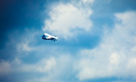 Biplane in blue Sky over clouds Stock Photo - 17467068