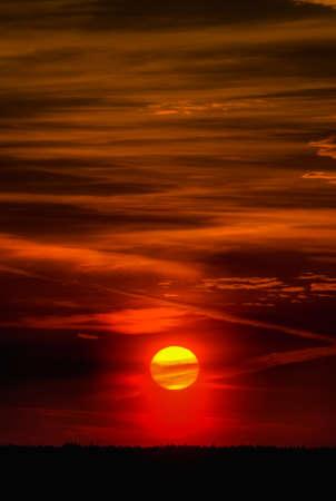 Big Sun Setting. Orange sky and dramatic sunbeams