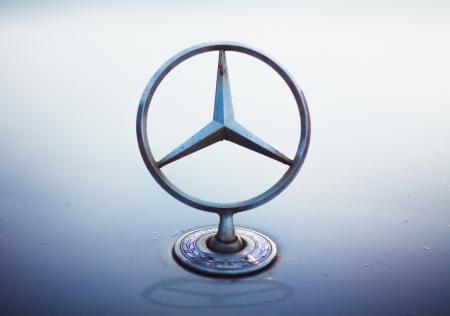 mercedes: Dirty Mercedes Benz silver star logo Editorial