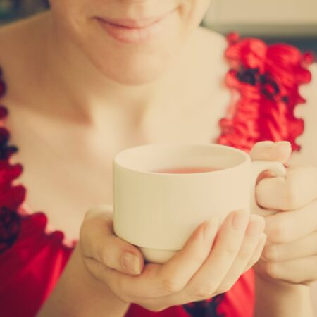 Beautiful Young Woman With Cup Of Tea