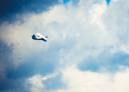 Biplane In Blue Sky Over Clouds photo