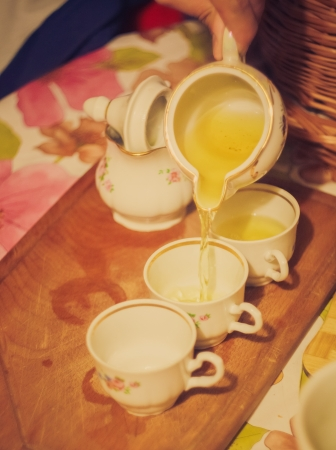 still life of the teapot flow green tea in cup on tea ceremony Stock Photo - 19331302