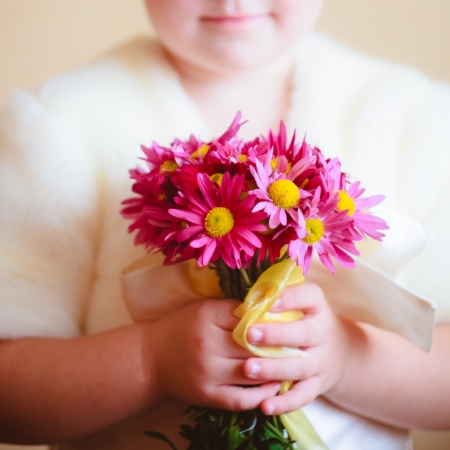 red hair girl: little girl with pink flowers asters in their hands Stock Photo