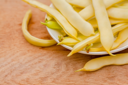 Fresh Yellow Kidney Beans In A Bowl Board Over Wood Background photo