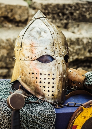 visor: Protective helmet with a visor on medieval knight. Medieval Templar helmet waiting for knight