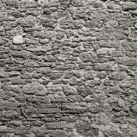 Old wall made of the Jerusalem stone. Wall constructed of stone bricks.