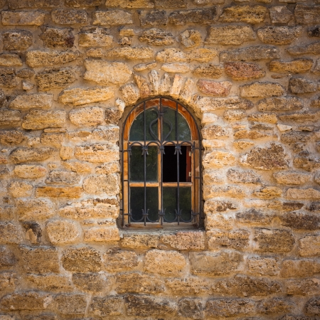 Old wall from the Jerusalem stone and window with lattice window Stock Photo