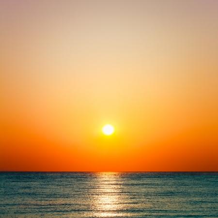 Setting sun on pacific ocean. Beautiful sunset at sea horizon