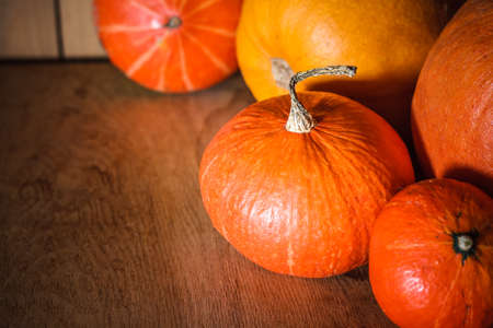 Pumpkins on grunge wooden backdrop, background table. Autumn, halloween, pumpkin, copyspace photo