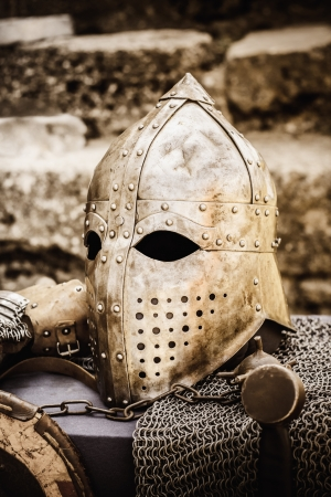 Protective helmet with a visor on medieval knight. Medieval Templar helmet waiting for knight photo