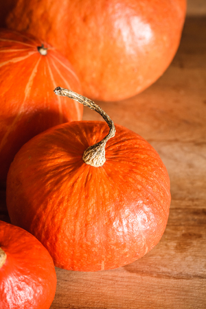 Pumpkins on grunge wooden backdrop, background table. Autumn, halloween, pumpkin photo