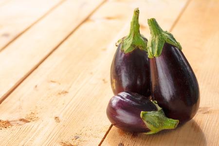 Healthy Organic Vegetables on a Wooden Background Banco de Imagens