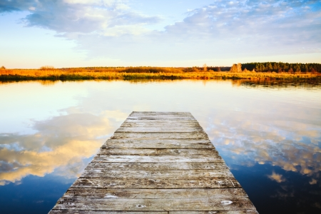 Old wooden pier. Calm river nature background photo