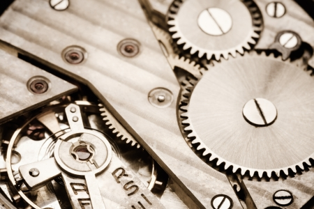 Clockwork Background. Close-up Of Old Clock Watch Mechanism With Gears photo