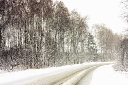 adverse: Snowy Land Road At Winter. Adverse weather conditions Stock Photo