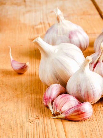 Healthy Organic Garlic Vegetables Whole And Cloves On The Wooden Background photo