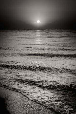 Black And White Dramatic Landscape With Sea Ocean Water Waves And Sun At Sunset Background photo