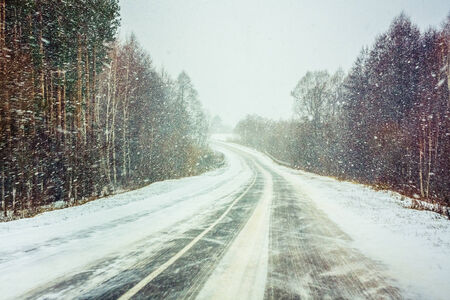 Snowy Land Road At Winter. Adverse Weather Conditions