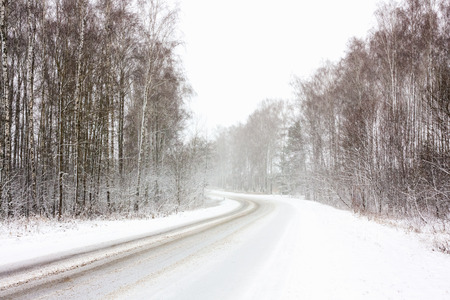 adverse: Snowy Land Road At Winter. Adverse Weather Conditions