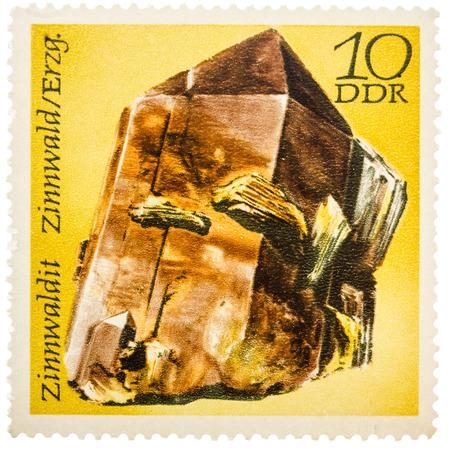 east germany: GDR- CIRCA 1972: Stamp printed in German Democratic Republic (East Germany) shows semiprecious stone Zinwaldit, Minerals Zinnwaldite, Zinnwald, circa 1972