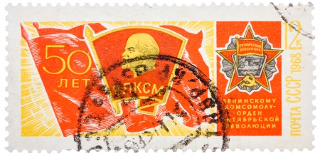 SOVIET UNION - CIRCA 1968: Stamp printed in USSR, shows banner of komsomol with badge and Order of October Revolution, devoted to the 50-th anniversary of komsomol, circa 1968