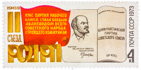 USSR - CIRCA 1973: Stamp printed in the Soviet Union shows membership card of the Communist Party of the Soviet Union, circa 1973 Editorial