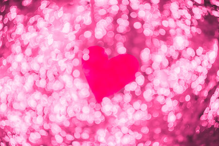 Red heart on pink bokeh abstract light Valentine's day background photo
