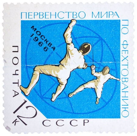 USSR - CIRCA 1966: A stamp printed in the USSR (Russia) shows two fencers with inscription and name of series World Fencing Championship, Moscow, 1966, circa 1966
