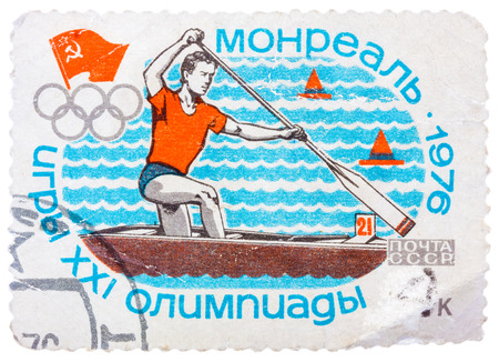 summer olympics: USSR - CIRCA 1976: Stamp printed in Russia (Soviet Union), Summer Olympics in Montreal, canoeing, athlete is swimming in a boat with a paddle, circa 1976