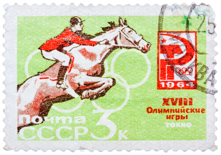 RUSSIA - CIRCA 1964: A stamp printed in USSR (Soviet Union), shows Equestrian and Russian Olympic Emblem. 18th Olympic Games, Tokyo, Scott Catalog 2921 A1465 3k red and green, circa 1964
