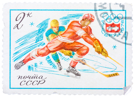 olympic symbol: USSR - CIRCA 1976: Stamp printed in Russia (Soviet Union) shows Winter Olympic Games Emblem and Ice Hockey, circa 1976