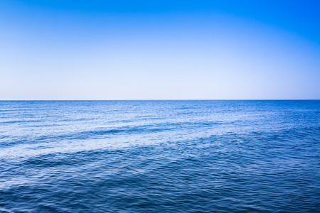 Calm sea ocean and blue clear sky Stok Fotoğraf