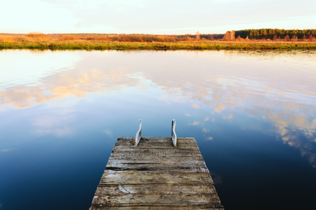 Old wooden pier. Calm river nature  photo