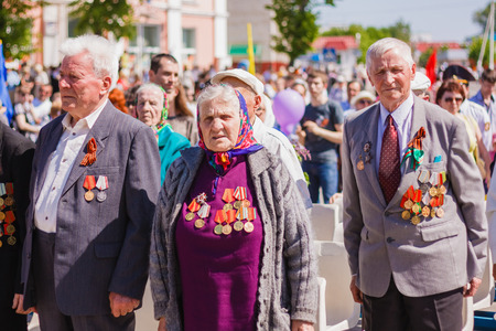 hymn: Gomel, BELARUS - MAY 9: Unidentified veterans standing listen to the Belarus hymn during the celebration of Victory Day on May 9, 2013 in Gomel, Belarus.
