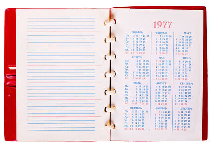 Open Blank Page Russian Notebook With Calendar, 1977 year. Old Paper Notepad Isolate On White Background photo