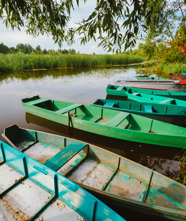 Autumn River And Old Green Rowing Boats. Russian Landscape, Nature Stock Photo